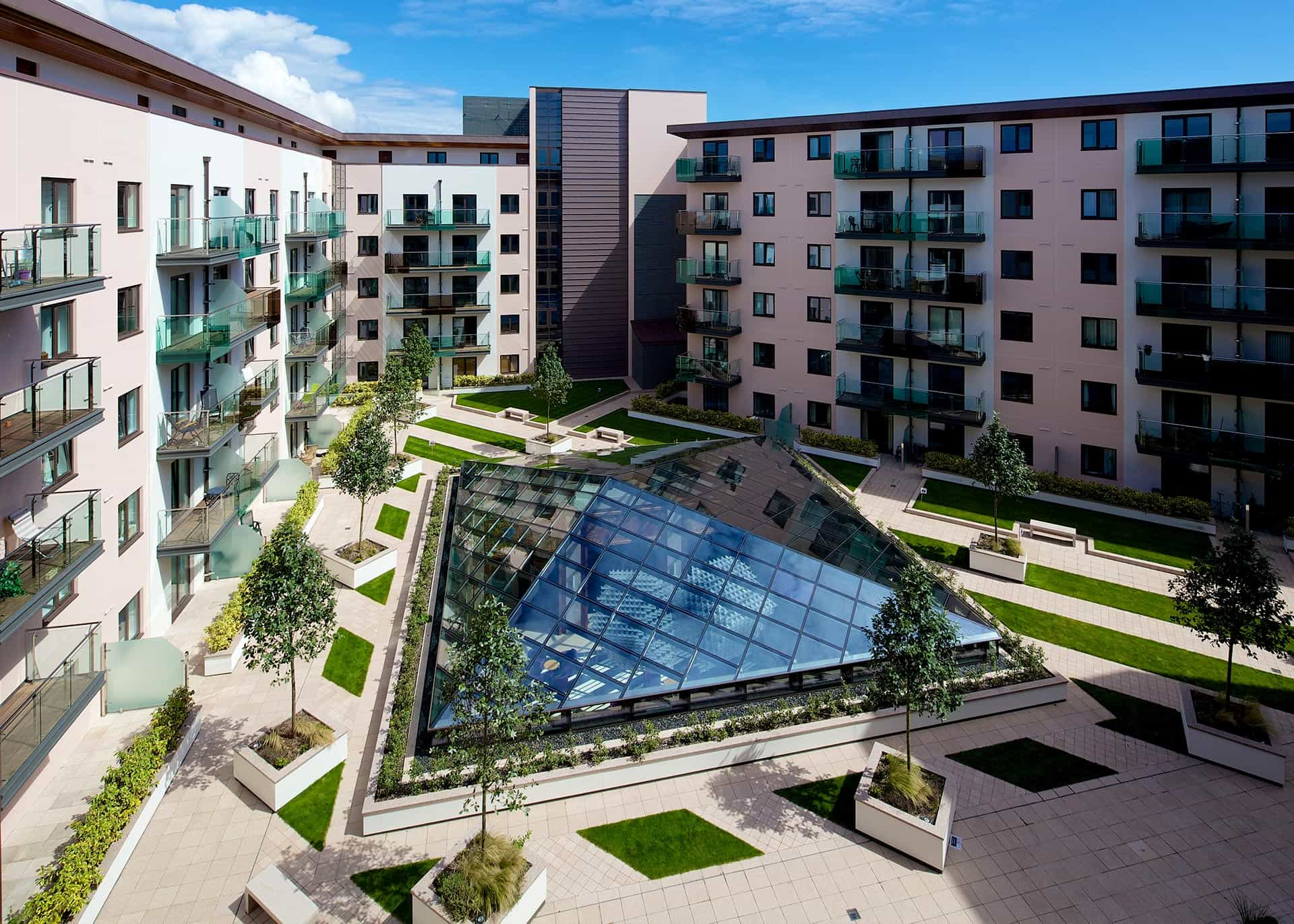 The shared courtyard at Castle Quay apartments, St Helier